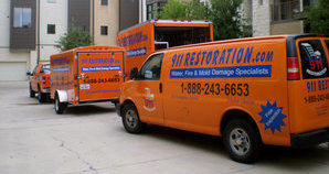 Fire Damage Restoration Vehicles On Job Location